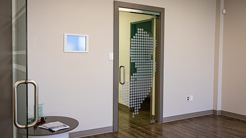 Glass Lobby Door with custom cut out New Jersey Logo