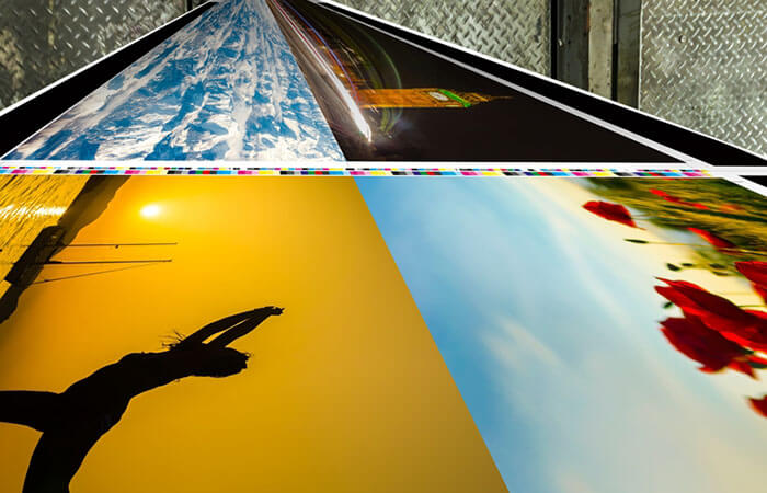Colorful photos coming out of a large-format printer