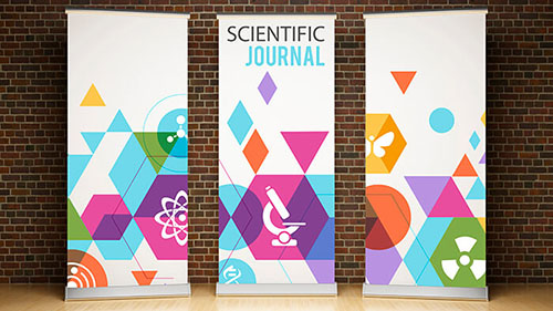 Three colorful pull-up banners against a brick wall