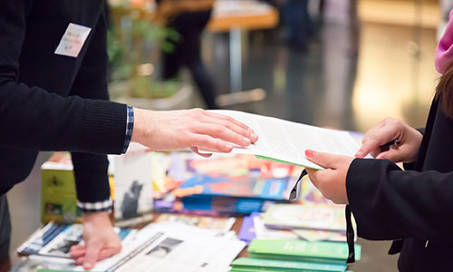 Trade show printed materials on a table